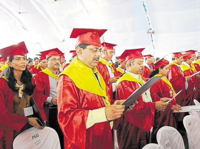 PhD degree holders and engineers taking pledge after receiving medals at the convocation ceremony of RGPV in Bhopal on Thursday.