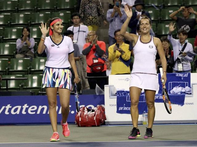 Sania Mirza, left, and her partner Barbora Strycova, of the Czech Republic, acknowledge the crowd.