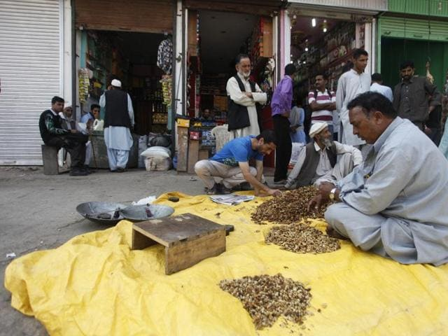 A shopkeeper sells walnut kernels at the market in Uri on Friday. The town made headlines earlier this month after four militants stormed an army camp and killed nineteen soldiers.