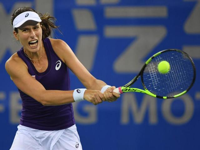 Johanna Konta of Britain serves during her quarterfinal against Petra Kvitova of the Czech Republic.