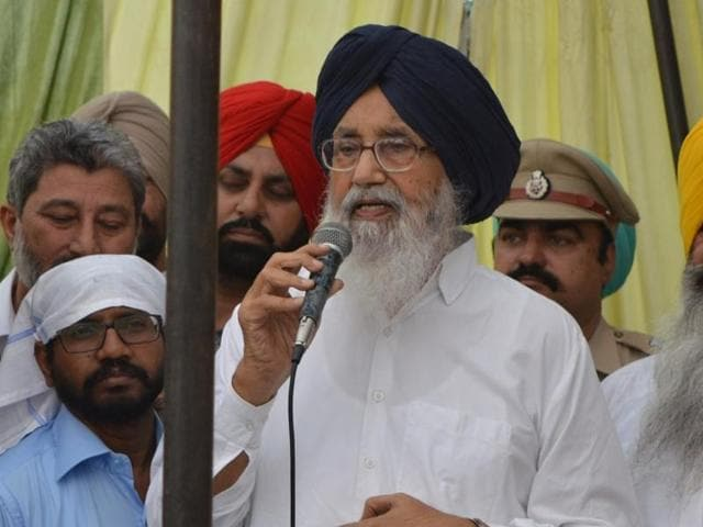 A woman shares her problems with CM Badal in Pathankot on Saturday.