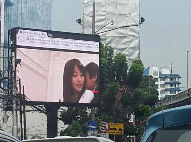 The pornographic video was broadcast on a public billboard in broad daylight in Jakarta and was captured on motorists' phones and sent viral on social media.