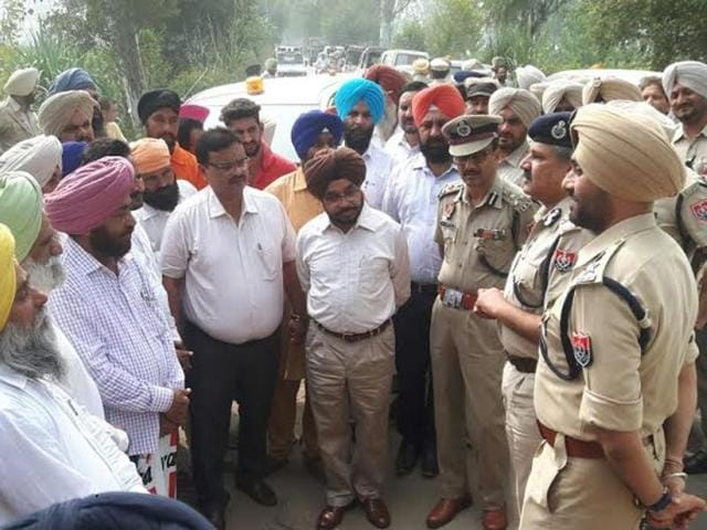 Police and administrative officials interacting with people at Ghanieke Bet village in Gurdaspur on Friday.