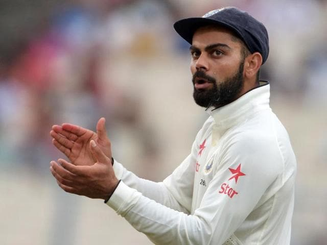Bhuvneshwar Kumar of India is being congratulated by captain Virat Kohli after taking Matt Henry's wicket.