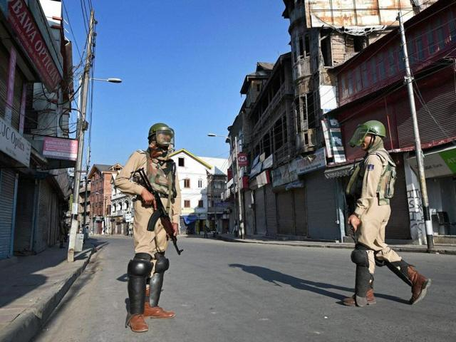 CRPF jawans stand guard during the curfew and strike in Srinagar.