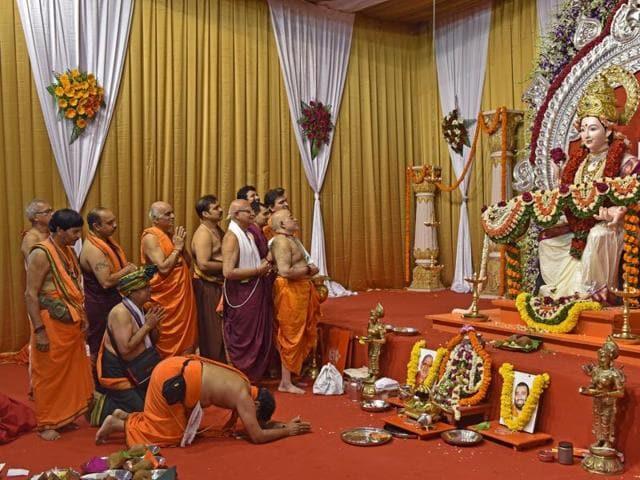 Devotees in prayer on first day of Navratri at the GSB Navratri festival in Dahisar on Saturday.
