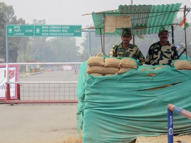 BSF personnel stand guard at the India-Pakistan Wagah Border.