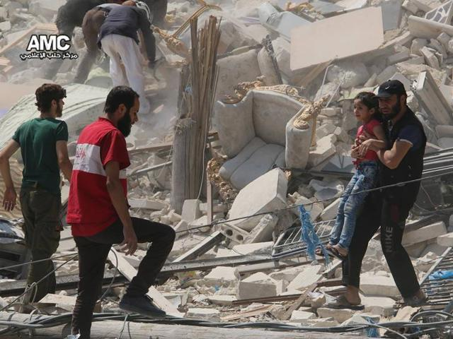 At least two barrel bombs hit the largest hospital in the rebel-held side of Syria's Aleppo city today, the medical organisation that supports it said.