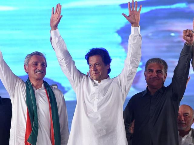 Pakistani cricketer-turned-politician Imran Khan waves to supporters during a public meeting in Raiwind, around 40km from Lahore.
