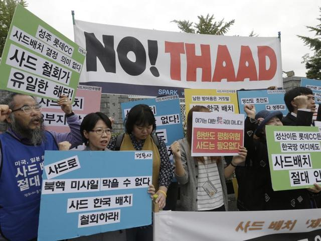 South Korean protesters shout slogans during a rally to oppose a deployment of THAAD in front of the defence ministry in Seoul, South Korea.
