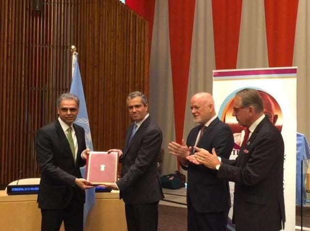India's envoy to the UN Syed Akbaruddin (left) presents instrument of ratification on the Paris climate-change deal in New York
