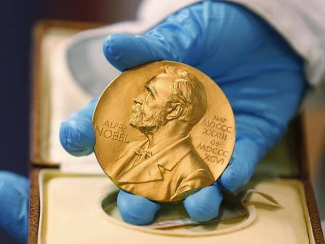 A national library employee shows the gold Nobel Prize medal awarded to the late novelist Gabriel Garcia Marquez, in Bogota, Colombia.