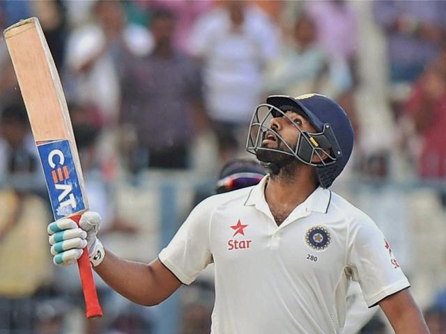 Indian cricketer Rohit Sharma celebrates his fifty.