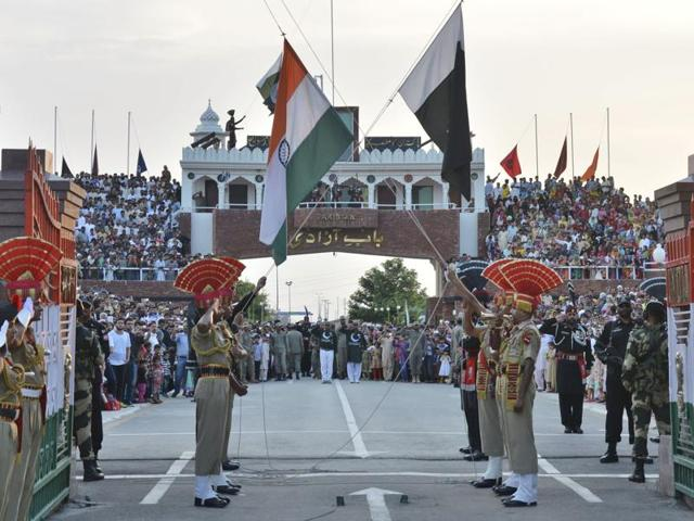 Indian and Pakistani flags are lowered during a daily retreat ceremony at the India-Pakistan joint border check post of Attari-Wagah near Amritsar.(AP File Photo)