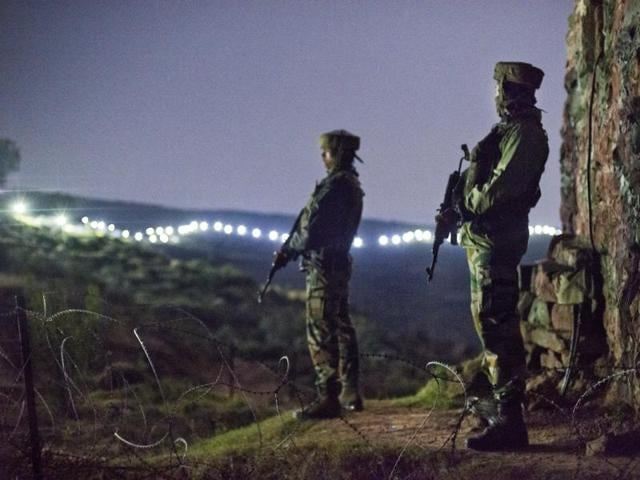 FILE PHOTO - Bhimber Gali, India - Sept. 28, 2015: Indian Army soldiers at forward posts beyond the illuminated fence in Hamirpur area near Bhimber Gali, about 180 km north west of Jammu,, India, on Monday, September 28, 2015. (Photo by Gurinder Osan/HT File Photo)