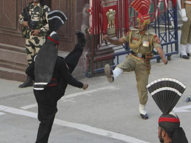 A routine daily flag-lowering ceremony at an Indian-Pakistani border crossing has become a show of strength and patriotism on the Pakistani side.