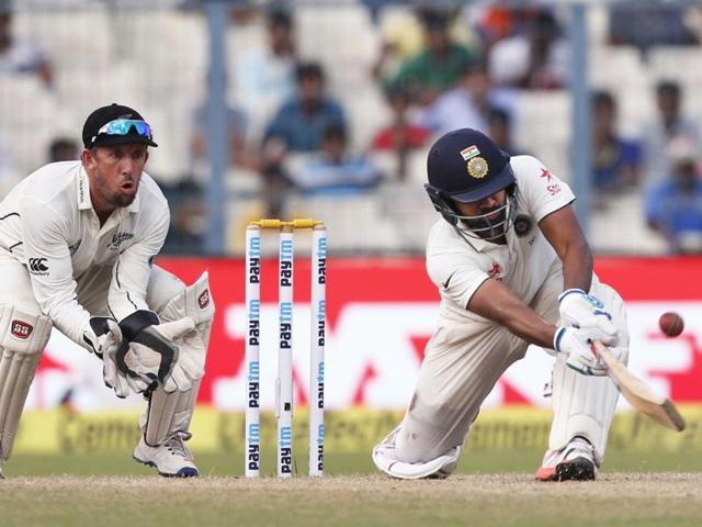 India's Rohit Sharma plays a shot against New Zealand.