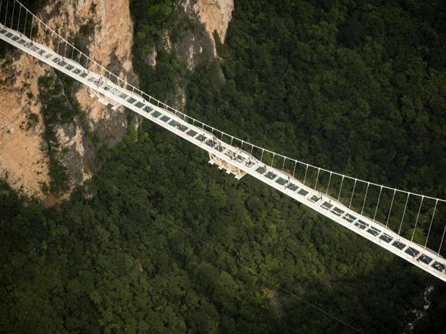 The world's highest and longest glass-bottomed bridge is seen above a valley in Zhangjiajie in China's Hunan Province.