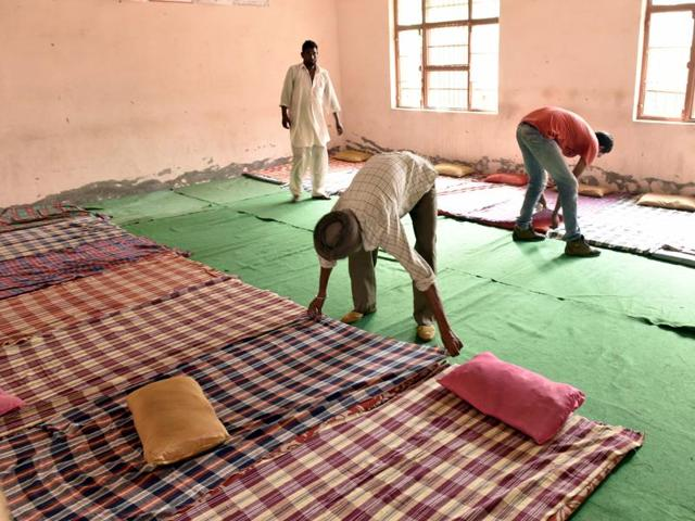 Volunteers arranging mattresses at a relief camp at Khassa village in Amritsar district.