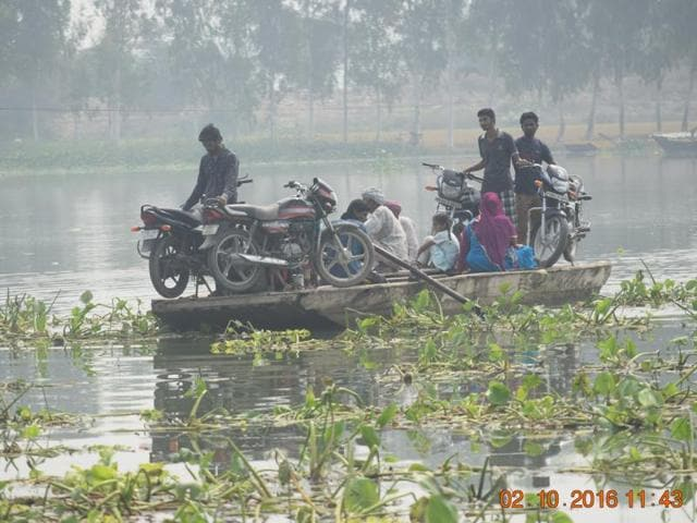 People leave a border village by boat.