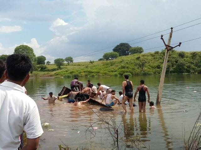 Nine killed,Bus falls in river,MP