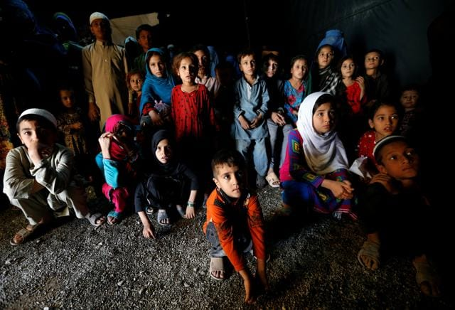 Afghan refugee children, returning from Pakistan at a United Nations High Commissioner for Refugees (UNHCR) registration centre in Kabul, Afghanistan.