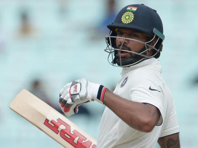 India's Shikhar Dhawan reacts after a ball hit his left hand during the third day of the second Test match.