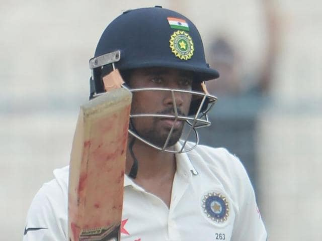India's Wriddhiman Saha celebrate after scoring a half-century during the fourth day of the second Test match.