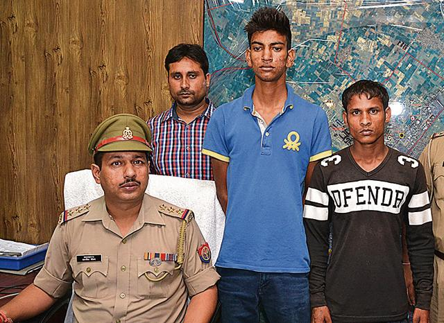 The prime accused, Shivam Tyagi (in blue shirt), said he got the inspiration from a movie and wanted to help the poor by constructing hospitals and charitable institutions from the extorted amount.(Sakib Ali/Hindustan Times)