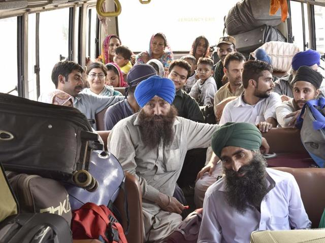 Pakistani jatha members in a bus after arriving at Attari on Monday.