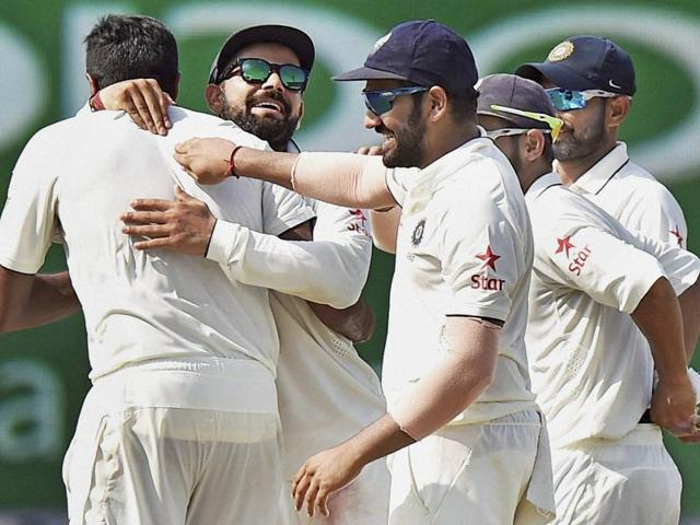 Indian players celebrate the fall of a wicket on the fourth day of the second Test match against New Zealand.