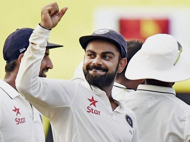 Virat Kohli and his teammates celebrating the wicket of Latham of New Zealand.