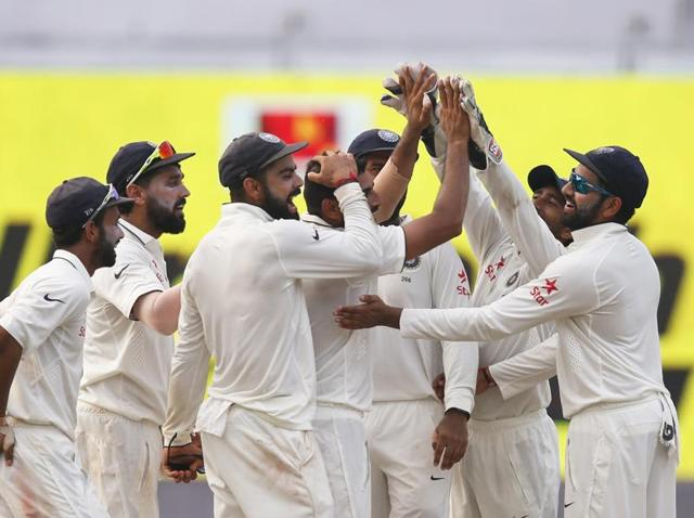 India's players celebrate the wicket of BJ Watling.