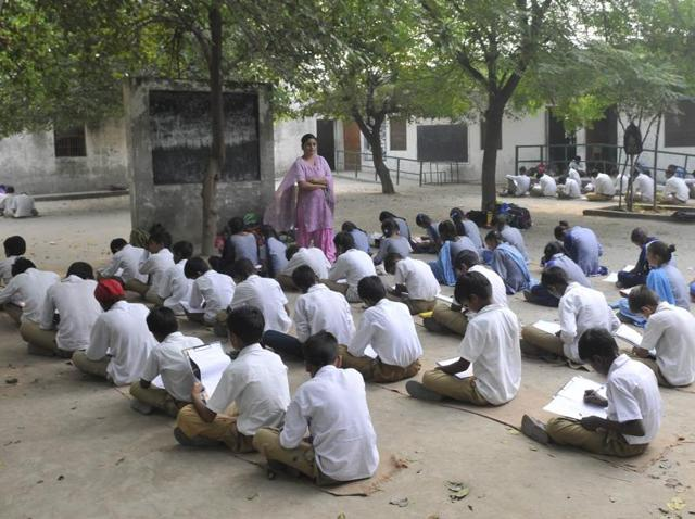 Students sitting in open at the Government Senior Secondary School, Kasabad, in Ludhiana.