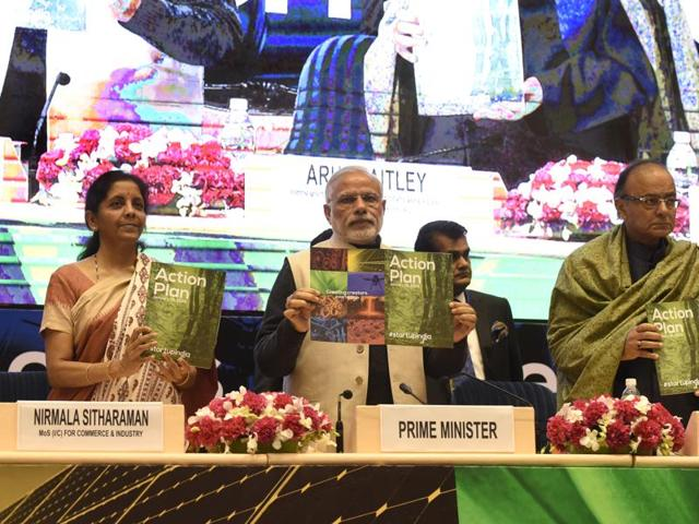 Prime Minister Narendra Modi (C), Finance Minister Arun Jaitley (R) and Minister of States for Independent Charge, Nirmala Sethuraman releasing the Action Plan at the launch of Startups India at Vigyan Bhavan in New Delhi on  January 16, 2016.
