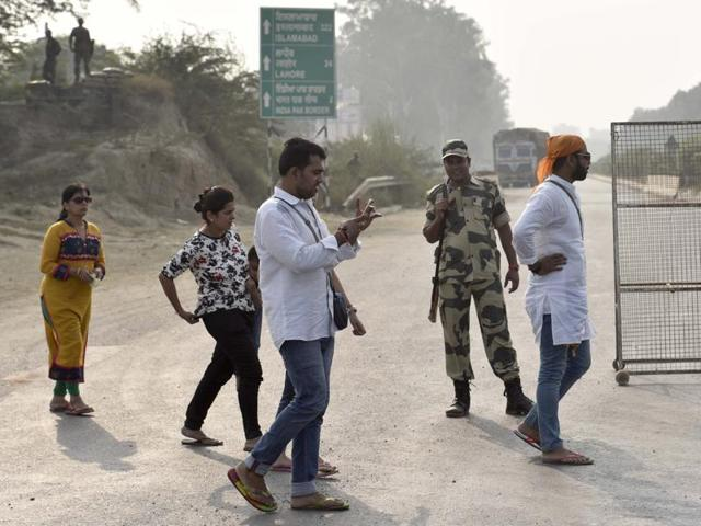 BSF jawans sending back visitors who wanted to watch the evening flag-lowering retreat ceremony at Attari border on Monday.