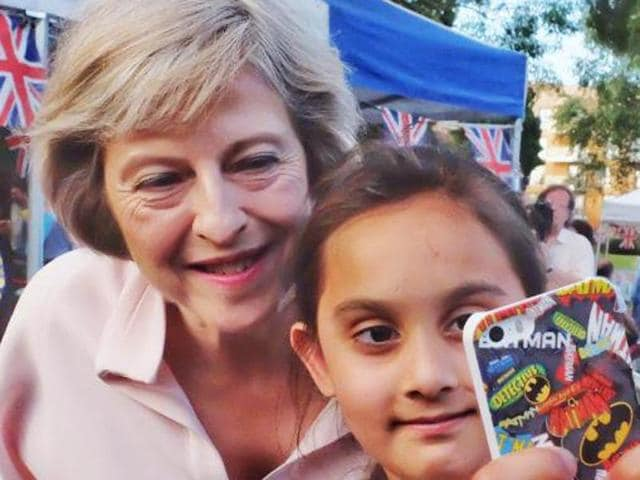 A young fan gets a selfie with the PM Theresa May at the  Maidenhead Festival 2016