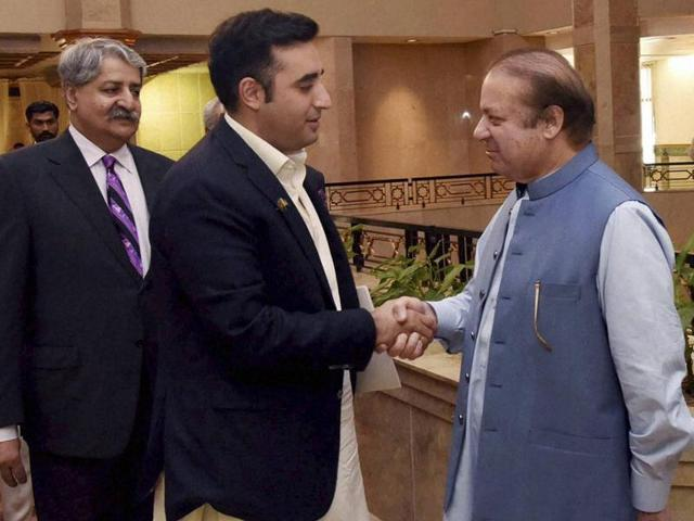 In this photo released by the Pakistan Press Information Department on Monday, Pakistani PM Nawaz Sharif (right) meets Bilawal Bhutto Zardari, chairman of the Pakistan People's party for a meeting in Islamabad. Leaders of all Pakistani political parties have been meeting to discuss the border situation with India.