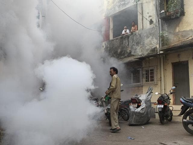 Mumbai, India - 8 Nov. 2014: Fumigation is done in the Locality of Andheri in Mumbai, India, on Saturday, November 8, 2014. . (Photo by Satish Bate/ Hindustan Times)