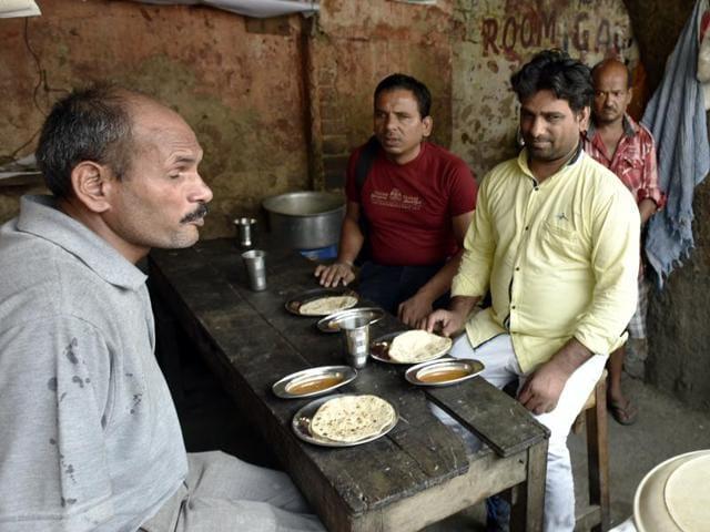 Visually impaired eating at a dhaba at GTB Nagar in New Delhi.