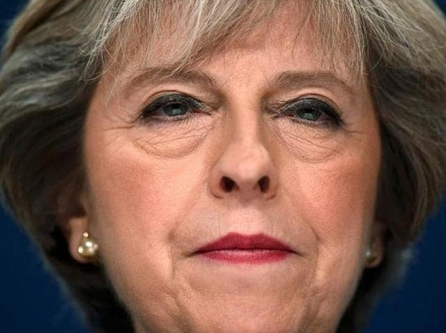 Britain's Prime Minister Theresa May listens to speeches at the Conservative Party conference in Birmingham on Monday.