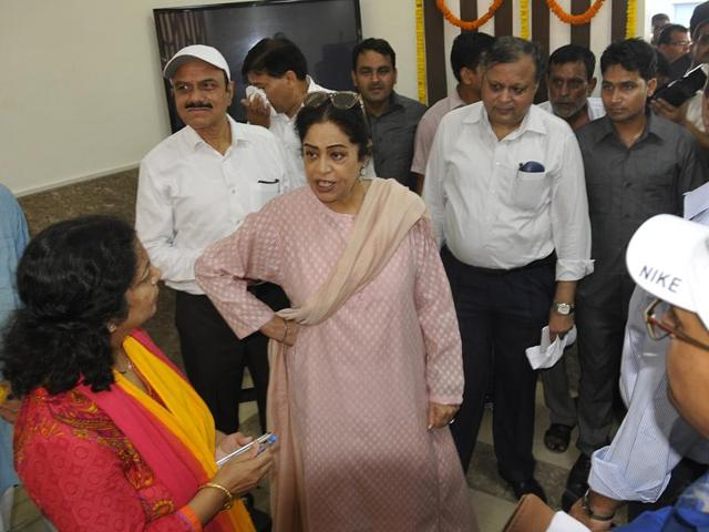 Member of Parliament Kirron Kher reprimanding a railway official during the inauguration of a child-care centre and executive lounge at the Chandigarh railway station on Monday.