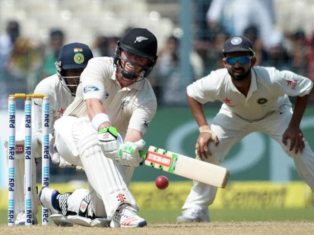 New Zealand's batsman Martin Guptill plays a shot on the fourth day of the second cricket test match against India in Kolkata.