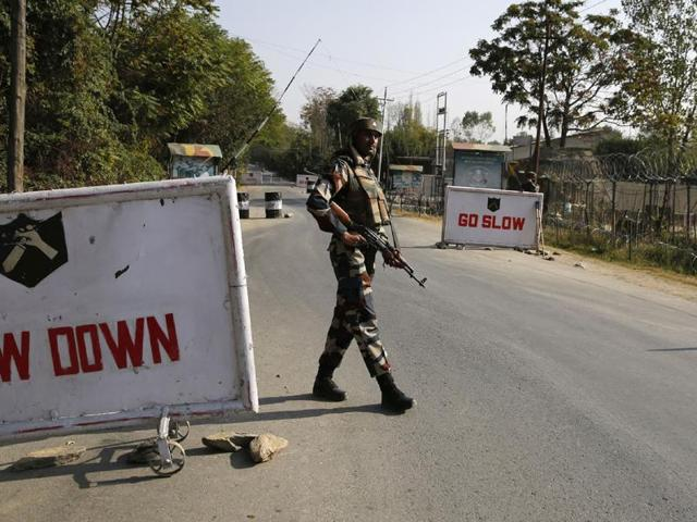 Indian Army soldiers stand guard at the entrance to an army camp in Baramulla, some 50km north-west of Srinagar.