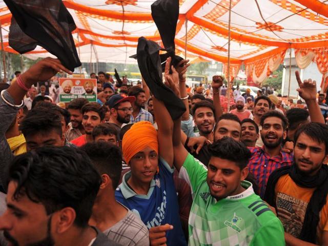 Supporters of Amarjit Singh Samra showing black flags to former Congress MLA Gurwinder Atwal during at Uggi village near Jalandhar on Monday.