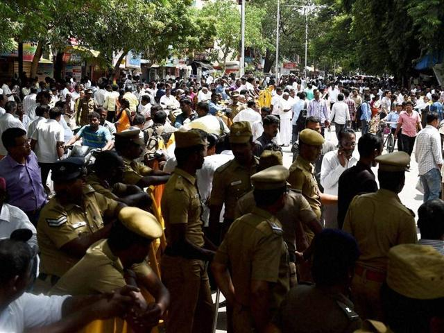 Police personnel and AIADMK workers gather outside the Apollo Hospital, where the Tamil Nadu chief minister Jayalalithaa has been admitted.