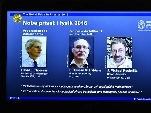An overhead projector displays the photos of the winners of the Nobel Prize in physics, at the Royal Swedish Academy of Sciences, in Stockholm, Sweden, on Tuesday.