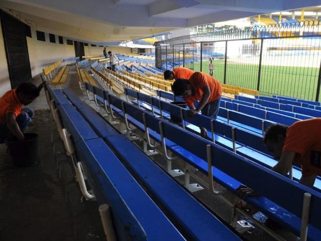MPCA staff prepare the cricket ground at Holkar stadium on Tuesday.