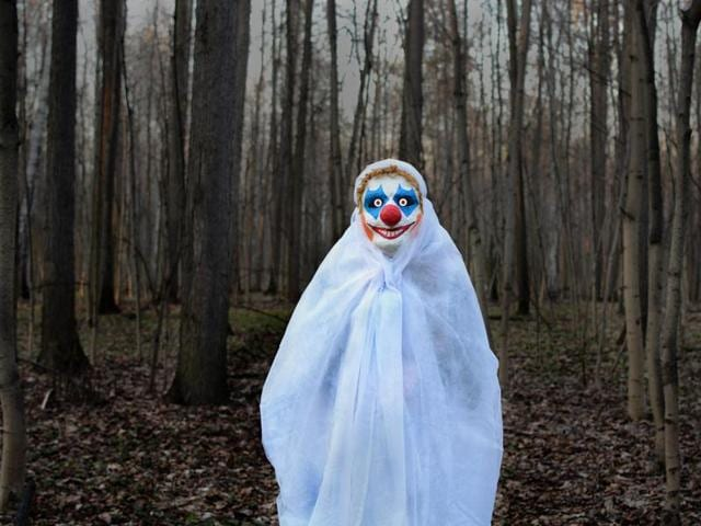 The student used a clown image on his social media site under the name Larry Brown to threaten the school.