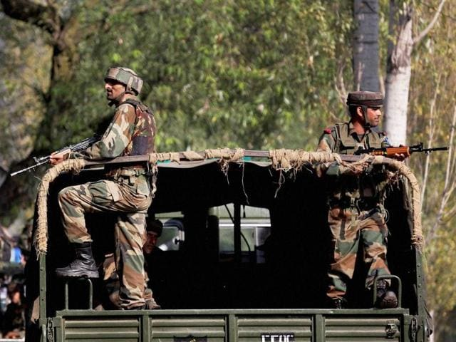 Soldiers guard outside the army base which was attacked suspected militants in Uri, Jammu and Kashmir on September 18, 2016.